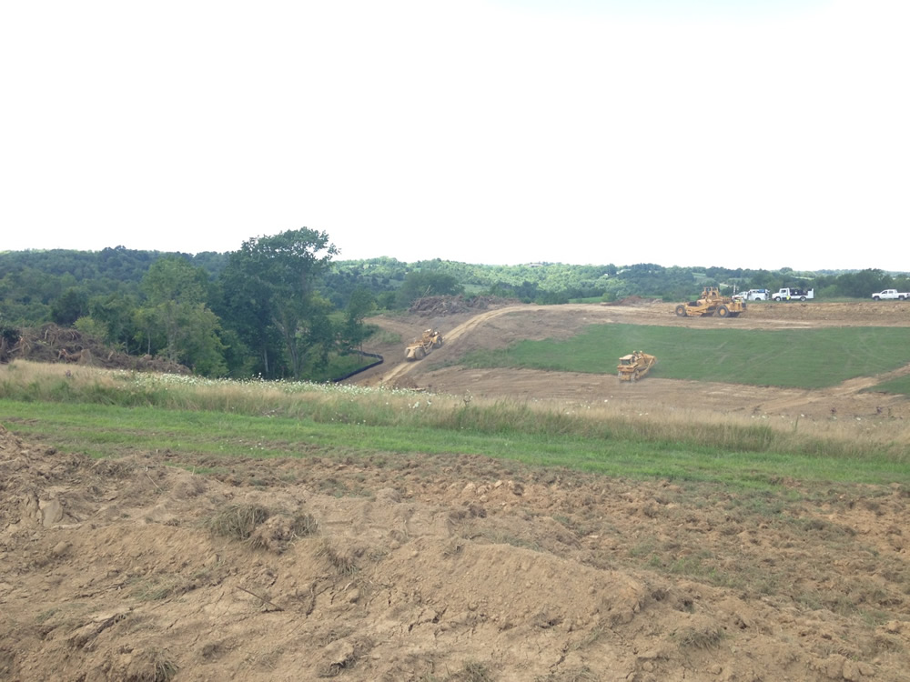 Ark site on Monday, August 11. Notice how deep the valley is next to the large tree on the left and compare with the following picture.