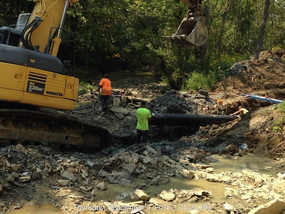 Installing a sewer line going under the creek