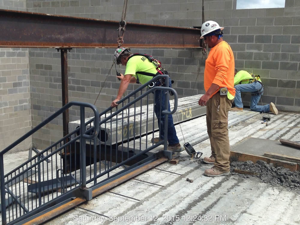 The placing of a precast in one of the towers to form a floor