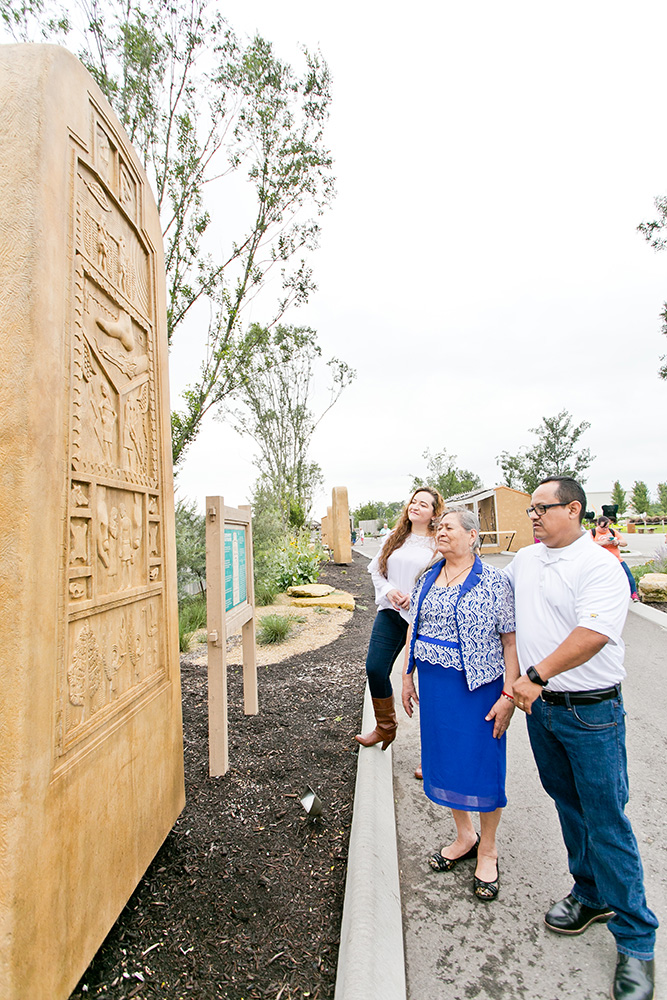 Family Looking at Stele in Monument Walk