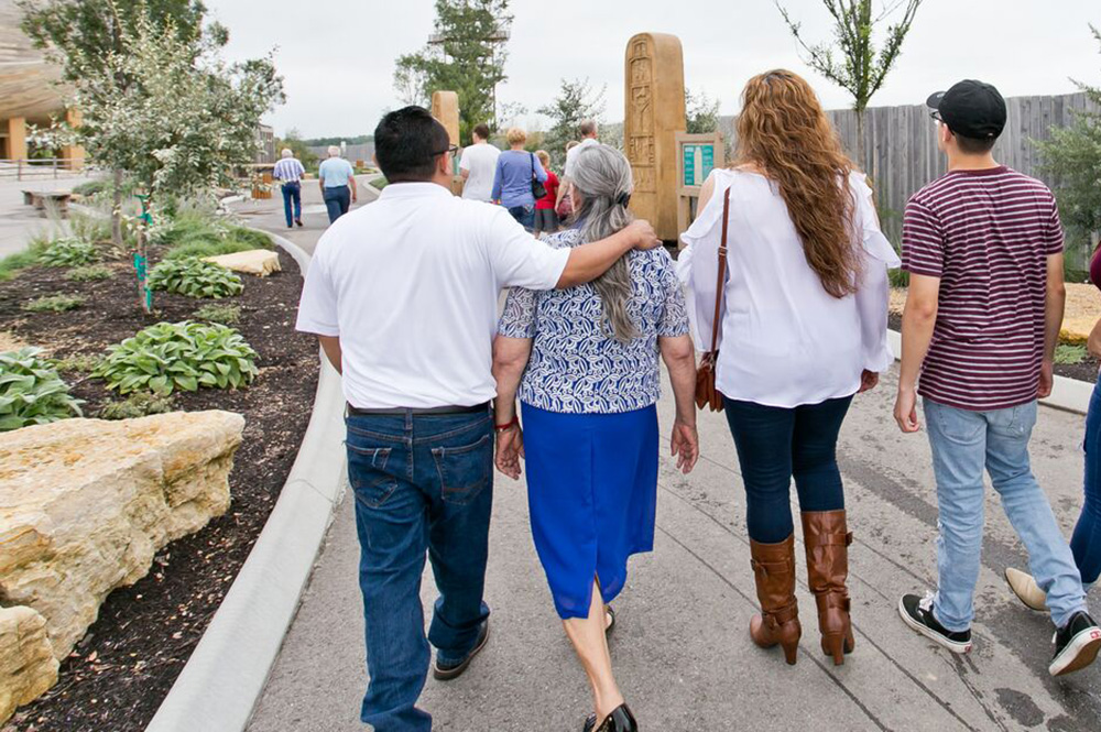 Family Walking Through Monument Walk