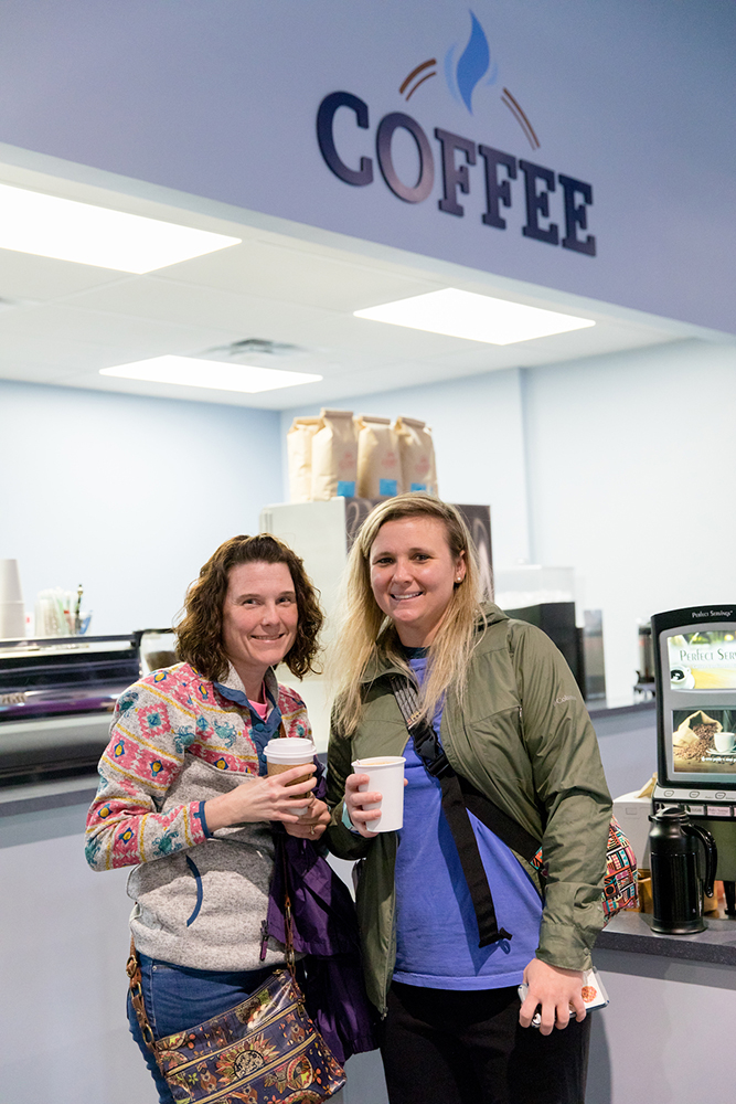 Guests with Coffee in Answers Center